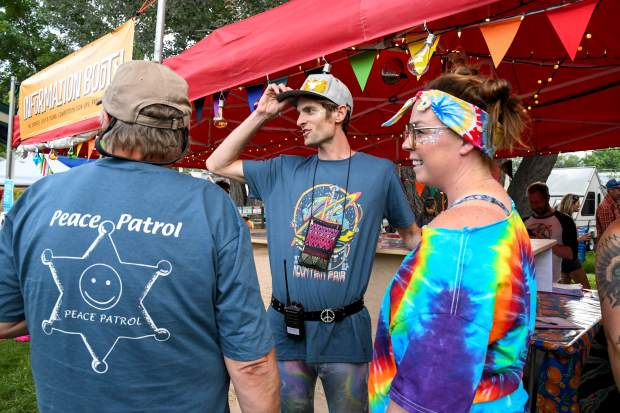 Michael Gorman walks with other volunteers at the 48th annual Carbondale Mountain Fair on Friday evening.