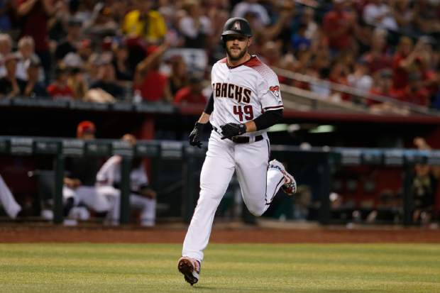 Arizona Diamondbacks' Alex Young scores a run on a double hit by Eduardo Escobar in the third inning during a baseball game against the Colorado Rockies, Sunday, July 7, 2019, in Phoenix. (AP Photo/Rick Scuteri)