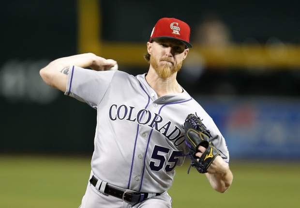 Colorado Rockies pitcher Jon Gray throws to the Arizona Diamondbacks during the first inning during a baseball game Saturday, July 6, 2019, in Phoenix. (AP Photo/Rick Scuteri)