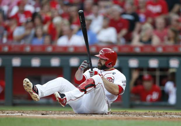 Cincinnati Reds' Jose Peraza (9) hits the ground after taking a swing for a strike against Colorado Rockies starting pitcher Chi Chi Gonzalez during the second inning of a baseball game, Saturday, July 27, 2019, in Cincinnati. (AP Photo/Gary Landers)