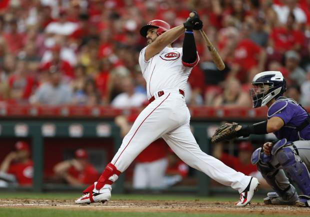 Cincinnati Reds' Eugenio Suarez (7) follows through on a two-run home run off Colorado Rockies starting pitcher Chi Chi Gonzalez during the third inning of a baseball game, Saturday, July 27, 2019, in Cincinnati. (AP Photo/Gary Landers)