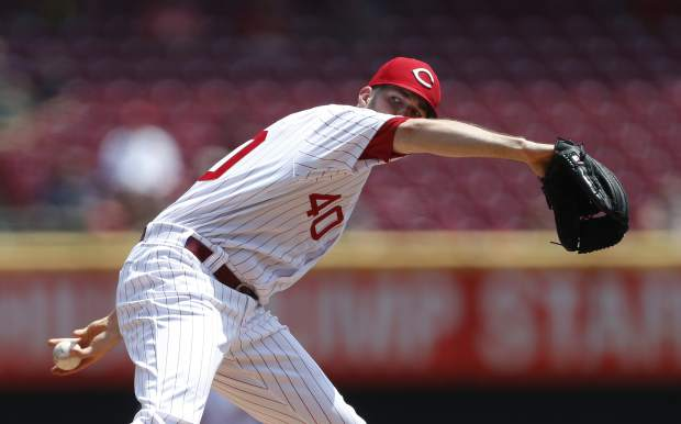 Cincinnati Reds starting pitcher Alex Wood (40) throws against the Colorado Rockies during the first inning of a baseball game, Sunday, July 28, 2019, in Cincinnati. (AP Photo/Gary Landers)