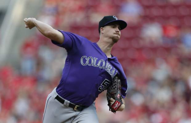 Colorado Rockies starting pitcher Chi Chi Gonzalez throws against the Cincinnati Reds during the first inning of a baseball game, Saturday, July 27, 2019, in Cincinnati. (AP Photo/Gary Landers)