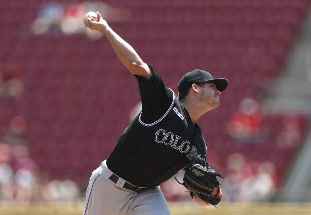 Colorado Rockies starting pitcher Peter Lambert throws against the Cincinnati Reds during the first inning of a baseball game, Sunday, July 28, 2019, in Cincinnati. (AP Photo/Gary Landers)