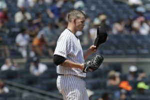Rockies beat Yanks 8-4 to stop slide
