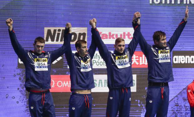 The United States men's 4x100m medley relay team stand on the podium to receive their silver medal at the World Swimming Championships in Gwangju, South Korea, Sunday, July 28, 2019. (AP Photo/Mark Schiefelbein)