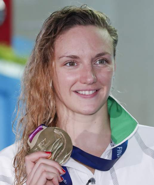 Gold Medalist Hungary's Katinka Hosszu posses with her medals following the women's 400m individual medley final at the World Swimming Championships in Gwangju, South Korea, Sunday, July 28, 2019. (AP Photo/Lee Jin-man)
