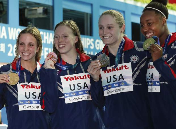 The United States women's 4x100m medley relay team, from left, Regan Smith, Lilly King, Kelsi Dahlia and Simone Manuel pose with their gold medals at the World Swimming Championships in Gwangju, South Korea, Sunday, July 28, 2019. (AP Photo/Lee Jin-man)