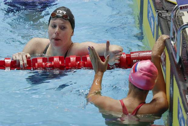 United States' Lilly King, left, is congratulated by Russia's Yuliya Efimova after winning the women's 50m breaststroke final at the World Swimming Championships in Gwangju, South Korea, Sunday, July 28, 2019. (AP Photo/Mark Schiefelbein)