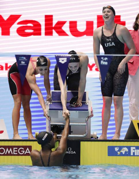 The United States women's 4x100m medley relay team celebrate after winning the final at the World Swimming Championships in Gwangju, South Korea, Sunday, July 28, 2019. (AP Photo/Lee Jin-man)