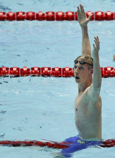 Germany's Florian Wellbrock celebrates after winning the men's 1500m freestyle final at the World Swimming Championships in Gwangju, South Korea, Sunday, July 28, 2019. (AP Photo/Mark Schiefelbein)
