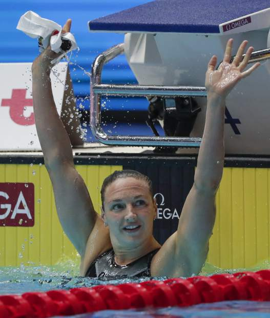 Hungary's Katinka Hosszu celebrates after winning the women's 200m individual medley final at the World Swimming Championships in Gwangju, South Korea, Monday, July 22, 2019. (AP Photo/Lee Jin-man)