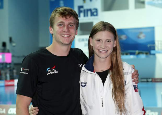In this Saturday July 20, 2019 photo, Ellie Smart and Owen Weymouth pictured at the World Swimming Championships in Gwangju, South Korea. American Smart and Brit Weymouth, two high divers at the world championships in Gwangju, fell in love not just with the sport of high diving but also with each other. They now travel the world competing together and coaching each other to new extremes. (AP Photo/Lee Jin-man)