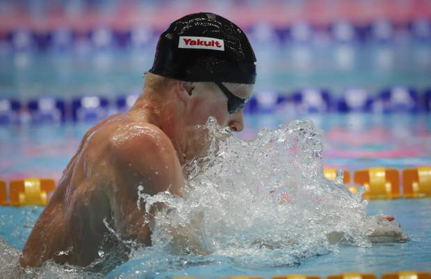 Britain's Adam Peaty swims in the men's 100m breaststroke final at the World Swimming Championships in Gwangju, South Korea, Monday, July 22, 2019. (AP Photo/Lee Jin-man)