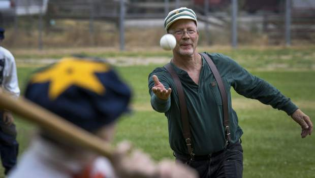 Hurler Greg Colasinski tosses in a pitch during game action Saturday in Silt. Using rules from the 1860s, the Colorado Vintage Base Ball Association takes the game back over a 150 years.