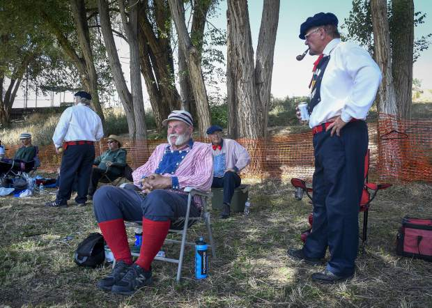 Members of the Star BBC of Silt and Star BBC of Colorado Territory relax in the shade before taking the field for the annual game at Silt Heydays last weekend.