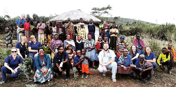 Dental and medical volunteers with villagers in Tanzania.