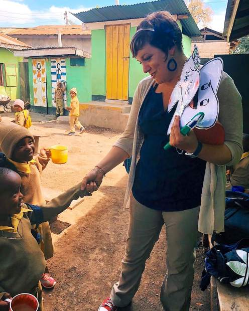 Annie Zancanella with some of the village children in Tanzania.