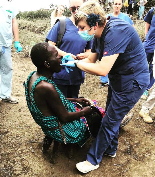 Annie Zancanella of Glenwood Springs provides a dental exam to one of the villagers in the African nation of Tanzania during her visit last fall.