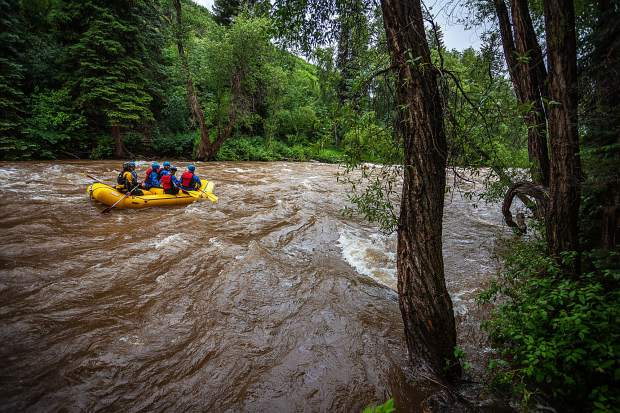 Rafters head down the Roaring Fork River on Tuesday. Pitkin County emergency responders are asking river runners to make a careful assessment before entering runoff-swelled water.