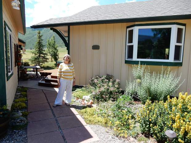 Marti Barbour stands outside her home in Emma. She was the first resident of the Roaring Fork Valley to receive assistance from Habitat For Humanity.