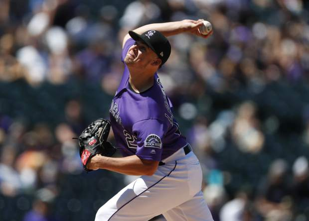 Colorado Rockies starting pitcher Peter Lambert works against the Miami Marlins in the first inning of a baseball game Sunday, Aug. 18, 2019, in Denver. (AP Photo/David Zalubowski)