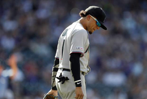 Miami Marlins second baseman Isan Diaz reacts after making a fielding error in the 10th inning of a baseball game against the Colorado Rockies, Sunday, Aug. 18, 2019, in Denver. (AP Photo/David Zalubowski)