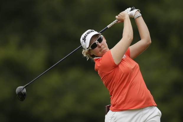 South Africa's Ashleigh Buhai hits a shot during the AIG Women's British Open golf championship at Woburn Gold Club near near Milton Keynes, England, Sunday, Aug. 4, 2019. (AP Photo/Tim Ireland)