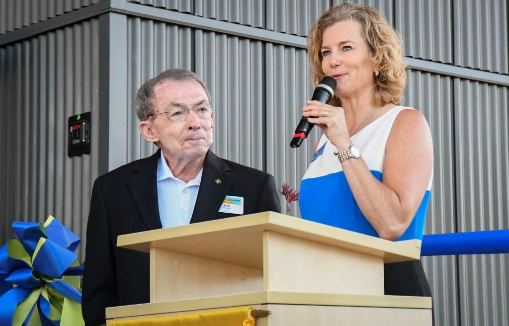 Carrie Besnette Hauser introduces Bob Young at the ribbon cutting and official building dedication ceremony for the new J. Robert Young Alpine Ascent Center at the CMC Spring Valley Campus.