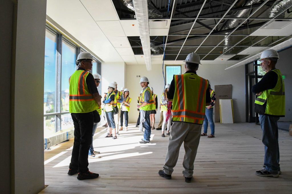 People tour the Outdoor Leadership Center & Field House as it enters the final phases of construction at the CMC Spring Valley Campus on Wednesday morning.