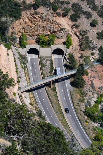 Cars enter the No Name tunnels just east of Glenwood Springs in Glenwood Canyon.