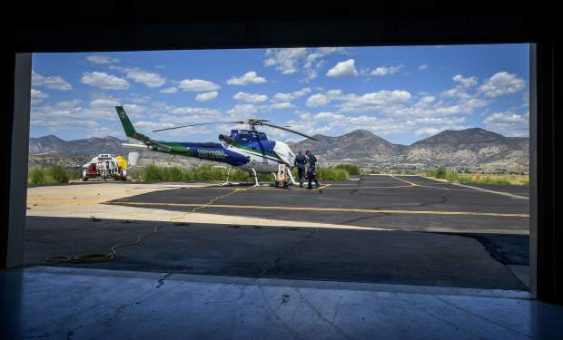 The crew readies the helicopter as they prepare for take off from their base located at Rifle Garfield County Airport.