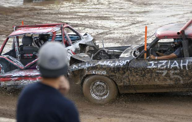 Action heats up in the arena as a fan gets an up close look at the carnage of the Demolition Derby action Saturday.
