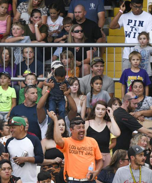 The grandstand is packed as demolition derby fans enjoy the action Saturday in Rifle.