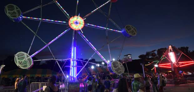 The carnival lights up the midway Friday night at the Garfield County Fairgrounds.