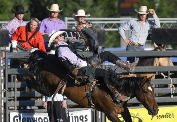 Bareback action kicks off the PRCA Pro Rodeo last Thursday at the Garfield County Fair.