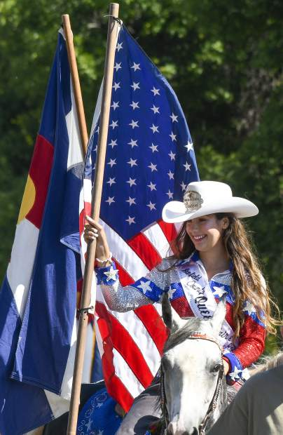 Garfield County Fair Queen Ashley Doose carries the American Flag during Saturdays parade.