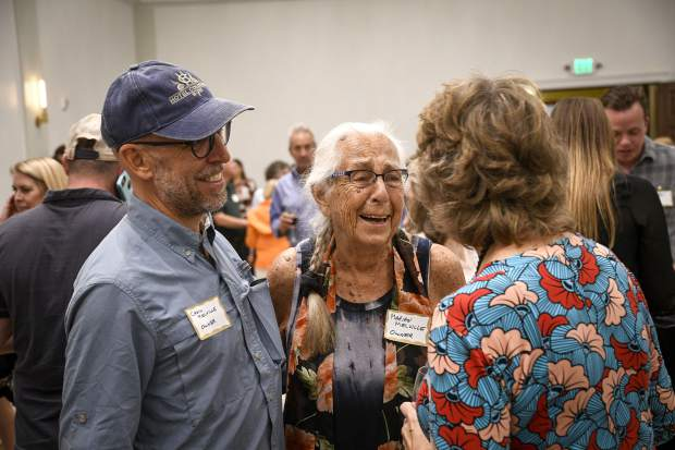 Marian Melville, center, and her son, Craig, talk with visitors during the Thursday evening festivties. Since purchasing the hotel in 2018, the Melville family has pledged all profits to restoring the historic building.