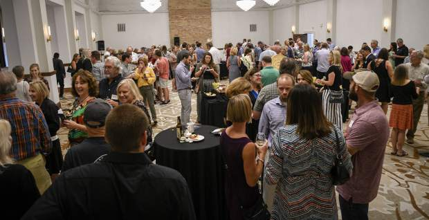 People gather in the Devereux Ballroom, enjoying food and beverages during Thursday's VIP open house at Hotel Colorado in Glenwood Springs.