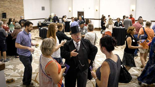 Don Moon portrays the 26th President of the United States, Theodore Roosevelt, while talking to guests during Thursday's VIP Open House at the Hotel Colorado in Glenwood Springs. Roosevelt stayed at the historic hotel several times in the early 1900s.