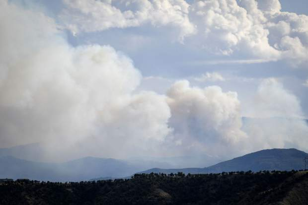 Smoke billows from the Middle Mamm Creek fire earlier this summer. The U.S. Forest Service is using a managed system to monitor the fire burning about 10 miles south of Rifle.