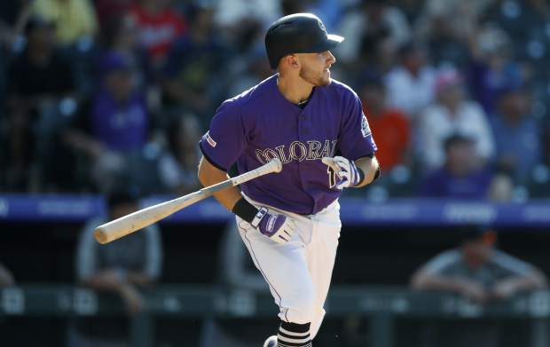 Colorado Rockies' Garrett Hampson tosses his bat and watches the flight of his walkoff RBI-single off Miami Marlins relief pitcher Jeff Brigham in the 10th inning of a baseball game Sunday, Aug. 18, 2019, in Denver. (AP Photo/David Zalubowski)