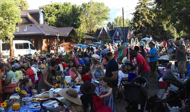 Townsfolk line the Fourth Street Plaza in downtown Carbondale Sunday evening for the Our Town, One Table community picnic.