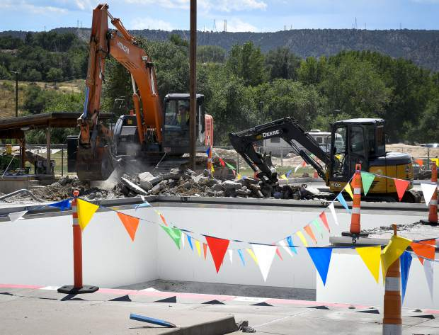 Heavy equipment works on demolishing the deck around the Art Dague Pool and Waterslide Tuesday in Rifle. The renovation and expansion of the aquatic facility is underway on the project in Metro Park.