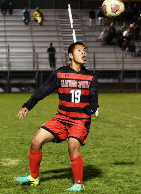 Glenwood Springs midfielder Carlos Rodriguez plays the ball out of the air last season at Stubler Memorial Field against Battle Mountain.