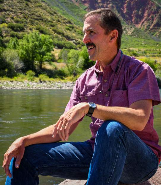 Chris Treese hangs out by the Colorado River at Two Rivers Park on a sunny afternoon in Glenwood Springs.