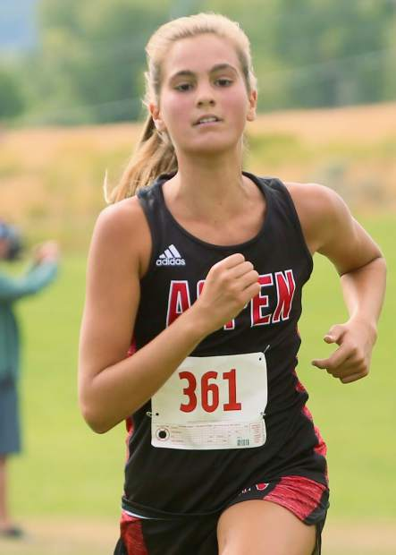 Aspen High School junior Kylie Kenny competes in the Longhorn Invitational on Saturday, Aug. 24, 2019, at Crown Mountain Park. She finished third in 21:06.8. (Photo by Austin Colbert/The Aspen Times)