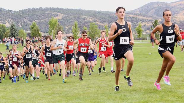 Racers take off from the start of the Longhorn Invitational on Saturday, Aug. 24, 2019, at Crown Mountain Park. (Photo by Austin Colbert/The Aspen Times)