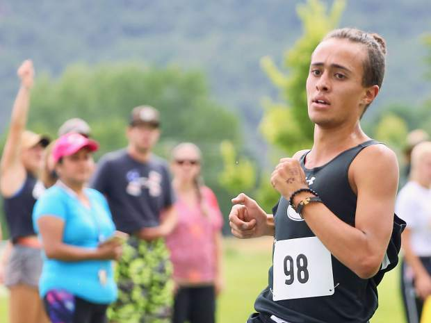 Gunnison High School junior Alex Baca competes in the Longhorn Invitational on Saturday, Aug. 24, 2019, at Crown Mountain Park. Baca won the race in 16:52.4. (Photo by Austin Colbert/The Aspen Times)