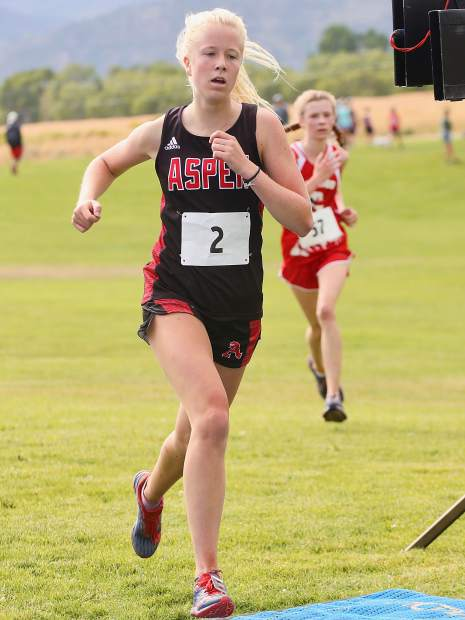 Aspen High School junior Kendall Clark competes in the Longhorn Invitational on Saturday, Aug. 24, 2019, at Crown Mountain Park. She finished fourth in 21:14.7. (Photo by Austin Colbert/The Aspen Times)